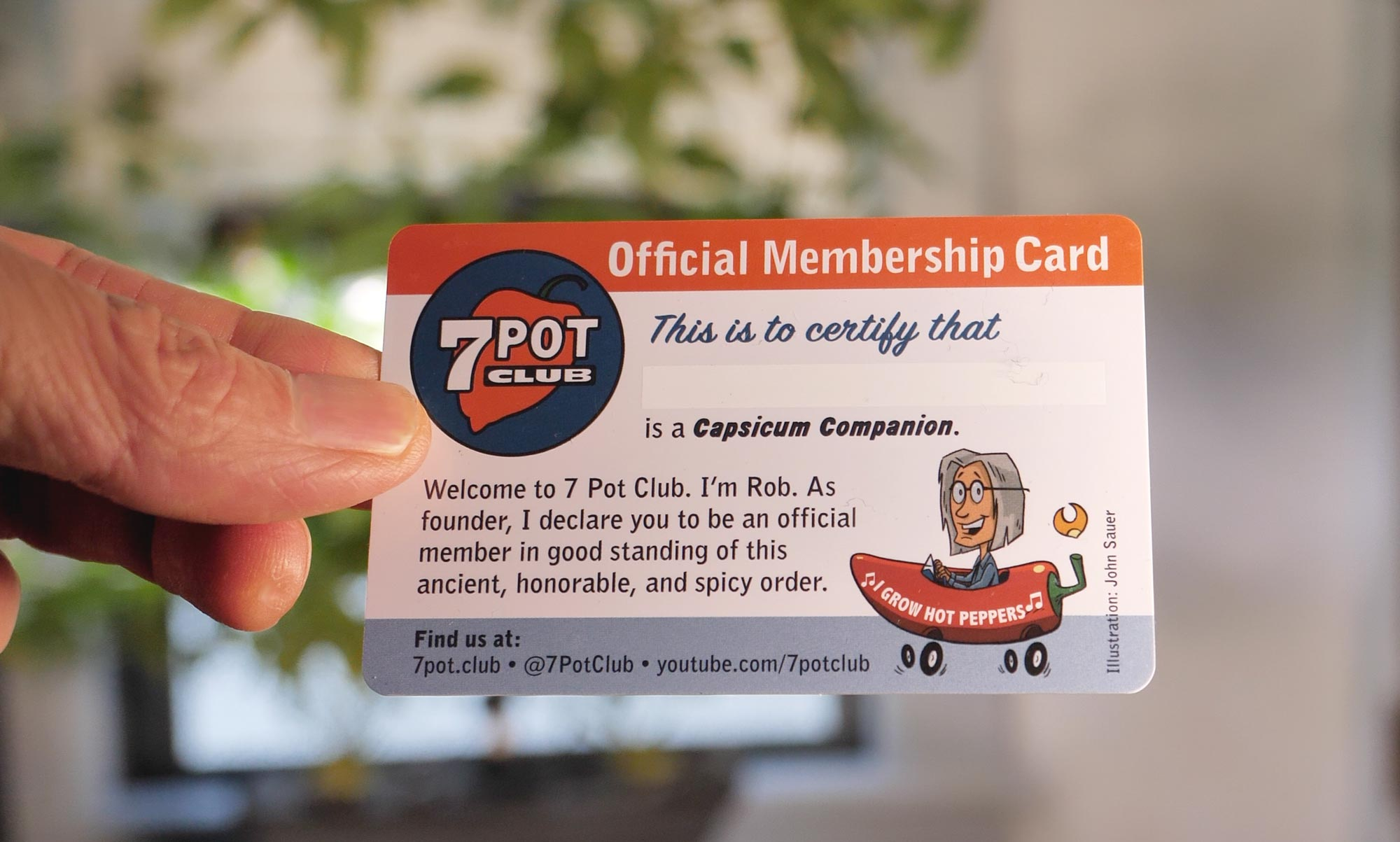 Photo of hand holding 7 Pot Club Membership Card