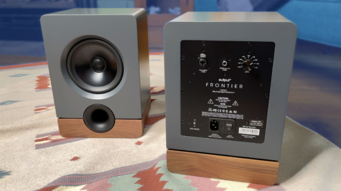 Photo of two Output Frontier Speakers, one facing forward and one facing backward